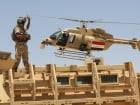 An Iraqi helicopter flies over a soldier in Husaybah, in Anbar province July 22, 2015. Iraqi security forces and Sunni tribal fighters launched an offensive on Tuesday to dislodge Islamic State militants and secure a supply route in Anbar province, police and tribal sources said. REUTERS/Stringer