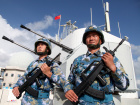 Soldiers of China's People's Liberation Army (PLA) Navy stand guard in the Spratly Islands, known in China as the Nansha Islands, February 10, 2016. REUTERS/Stringer