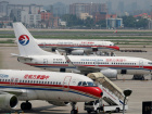 China Eastern Airlines planes are seen on the tarmac at Hongqiao International Airport in Shanghai, July 29, 2014. REUTERS/Aly Song/File Photo