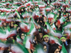 Students wave Iranian national flags during a ceremony to mark the anniversary of Iran's 1979 Islamic Revolution in Tehran's Azadi (Freedom) Square February 10, 2009. REUTERS/Raheb Homavandi (IRAN)