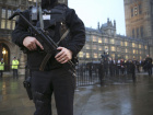 An armed police officer stands outside the Houses of Parliament, central London