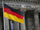 German flag is seen outside the German lower house of parliament Bundestag before the election of a new chancellor in Berlin, Germany, March 14, 2018. REUTERS/Hannibal Hanschke