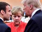 French President Emmanuel Macron, German Chancellor Angela Merkel and U.S. President Donald Trump confer at the start of the first working session of the G20 meeting in Hamburg, Germany