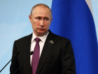 Russian President Vladimir Putin looks on during a news conference at the G-20 summit in Hamburg, Germany