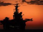 Aircraft carrier at sunset. Pixabay/Public domain