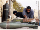 Free Syrian Army fighters prepare mortar shells during clashes with forces loyal to Syria's President Bashar al-Assad in the Handarat area, north of Aleppo
