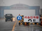 A traffic sign is seen on the Grand Unification Bridge which leads to the truce village Panmunjom, just south of the demilitarized zone separating the two Koreas, in Paju