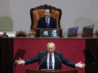 U.S. President Donald Trump delivers a speech as South Korea's National Assembly Speaker Chung Sye-kyun listens at the National Assembly in Seoul, South Korea