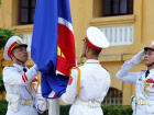 Honour guards raise an Association of Southeast Asian Nations (ASEAN) flag at a flag-raising ceremony to mark the 50th anniversary of the regional group at Vietnam's Ministry of Foreign Affairs in Hanoi