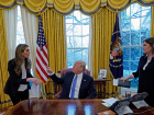 U.S. President Donald Trump speaks with Hope Hicks during an interview with Reuters in Washington