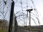 A surveillance camera is seen near a barbed-wire fence inside the Chinon Nuclear Power Plant