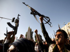 Followers of the Houthi group raise their weapons as they demonstrate against an arms embargo imposed by the U.N. Security Council on the group