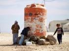 Image: Syrian children filling water bottles at Zaatari refugee camp in Jordan, 2015. Photo by Mustafa Bader, CC BY-SA 4.0.