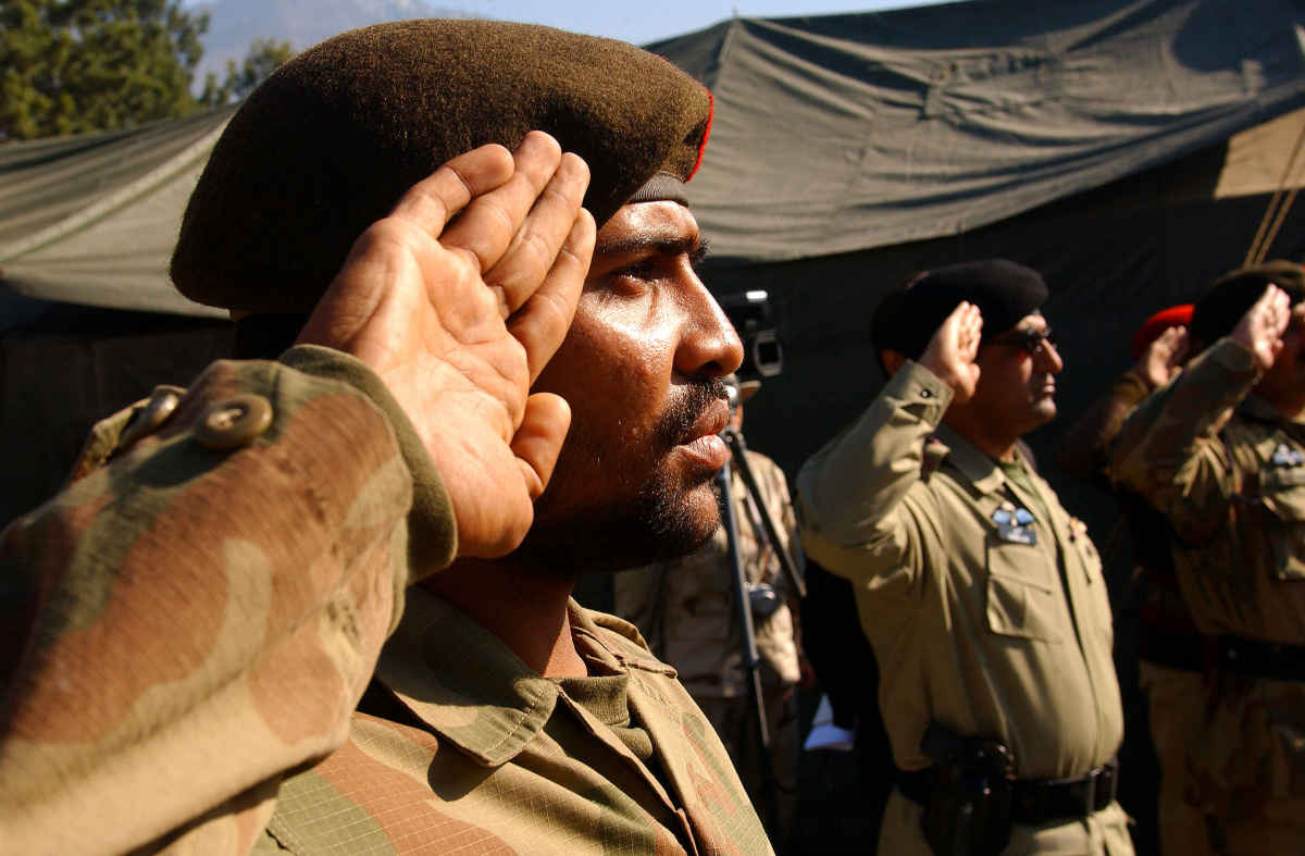 Pakistan army soldiers with 67th Medical Battalion salute during a transfer of authority ceremony in Muzaffarabad, Pakistan, February 16, 2006. U.S. Air Force / Tech. Sgt. Joseph McLean