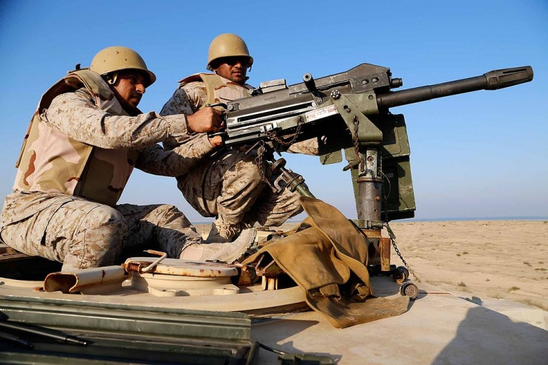 """Image: """"5TH FLEET AREA OF RESPONSIBILITY (Dec. 11, 2014) A Saudi Marine fires an Mk19 grenade launcher during a joint machinegun live-fire exercise with U.S. Marines from Echo Company, Battalion Landing Team 2nd Battalion, 1st Marines, 11th Marine Expeditionary Unit (MEU), as part of exercise Red Reef 15 in the U.S. 5th Fleet area of responsibility, Dec. 11, 2014. Red Reef, is part of a routine theater security cooperation engagement plan between the U.S. Navy, U.S. Marine Corps and Royal Saudi Naval Forces"""