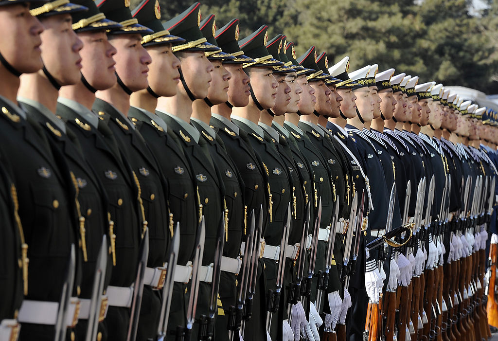 Chinese soldiers of the People's Liberation Army prepare for an honors ceremony for U.S. Defense Secretary Robert Gates as he arrives in Beijing, China, on January 10, 2011.