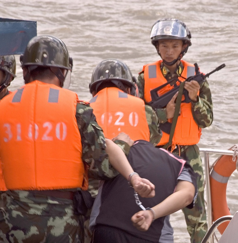 Image: (Aug. 18, 2007) SHANGHAI, China - A boarding team, from the U.S. Coast Guard 378-foot High Endurance Cutter Boutwell, demonstrates along with the Chinese Coast Guard their specific boarding techniques and procedures on Saturday here. The crew from the Boutwell is representing the U.S. Coast Guard here and other foreign ports to help increase international maritime security and safety in the Northern Pacific Ocean and its borders as part of the North Pacific Coast Guard Forum. (Coast Guard photo by Pe