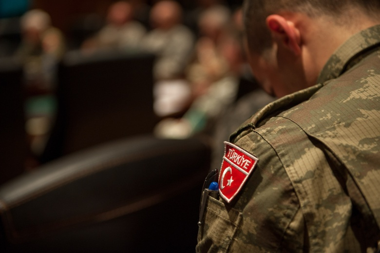 """Image: """"A Turkish soldier takes notes during a briefing at the NATO LANDCOM building at Izmir, Turkey, Feb. 4, 2014. (U.S. Army Photo by Sgt. Mikki L. Sprenkle/Released)"""""""