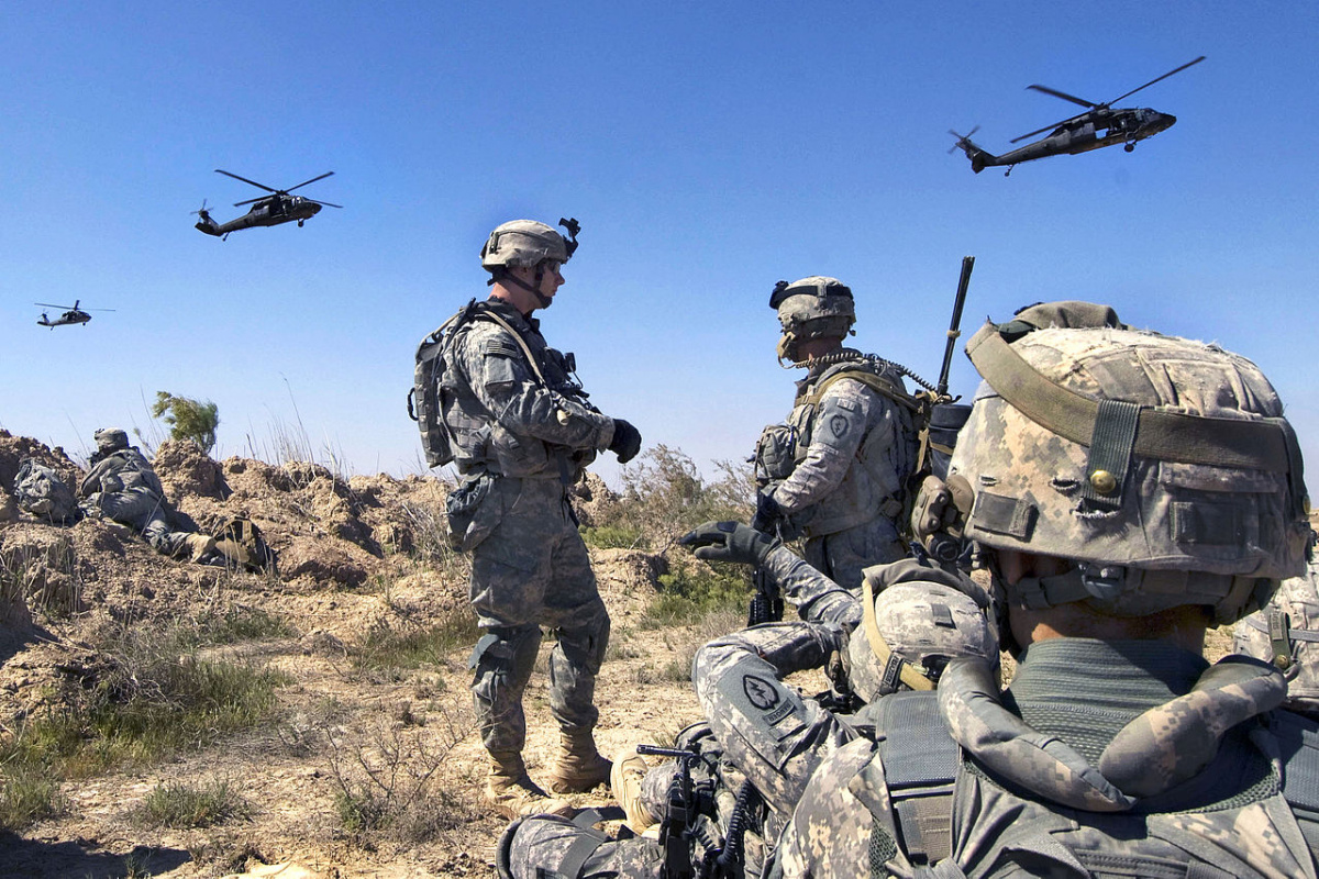 U.S. Army Soldiers wait to be picked up by UH-60 Black Hawk helicopters south of Balad Ruz, Iraq, March 22, 2009. The Soldiers are assigned to the 25th Infantry Division's 1st Battalion, 24th Infantry Regiment, 1st Stryker Brigade Combat Team. DoD photo by Mass Communication Specialist 2nd Class Walter J. Pels. Wikimedia Commons