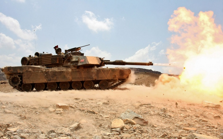 """Image: """"A M1A1 Abrams battle tank from Tank platoon Alpha Company, Battalion Landing Team 1st Battalion, 9th Marine Regiment, 24th Marine Expeditionary Unit, discharges a 120mm round towards a tank hull during a live-fire range in Djibouti, Africa March 30. Marine tank crewmen engaged various targets alongside the French 13th Foreign Legion Demi-Brigade as part of a joint exercise. The 24th MEU is currently serves as the theatre reserve force for Central Command during its seven month deployment aboard Nass"""