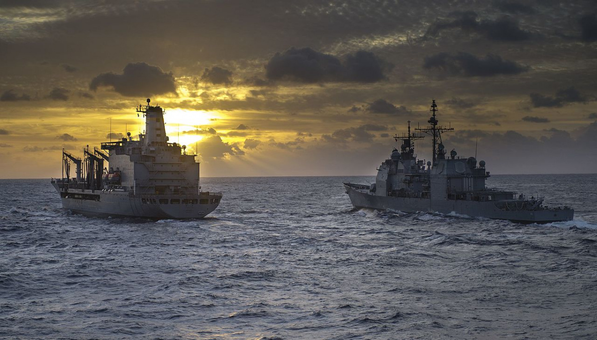 The fleet replenishment oiler USNS Patuxent, left, and the guided missile cruiser USS Leyte Gulf prepare for a replenishment at sea in the Atlantic Ocean Dec. 1, 2013. The Leyte Gulf was part of the George H.W. Bush Carrier Strike Group and was underway conducting pre-deployment training. Wikimedia Commons / Mass Communication Specialist 3rd Class Justin Wolpert, U.S. Navy​