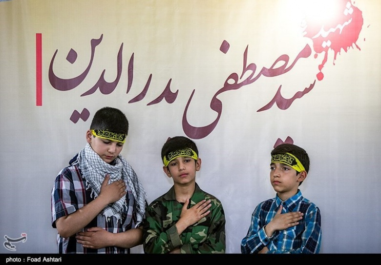 Image: Children at a ceremony honoring Mustafa Badreddine. Tasnim News Agency/Foad Ashtari, CC BY 4.0.