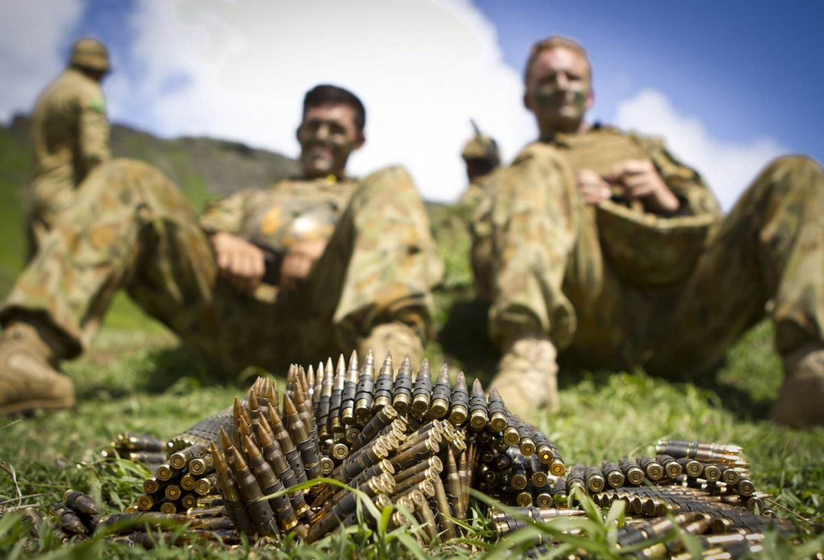 Australian soldiers with Delta Company, 5th Battalion, Royal Australian Regiment wait to finish off the last of their 7.62 mm rounds after a tactical live-fire demonstration during the Rim of the Pacific 2014 exercise.