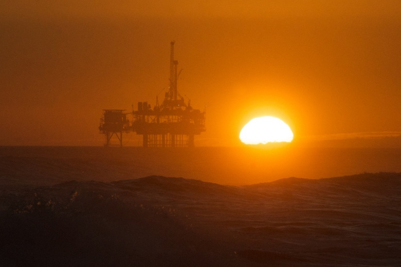 Image: An offshore oil rig at sunset. Pete Markham, CC BY-SA 2.0.