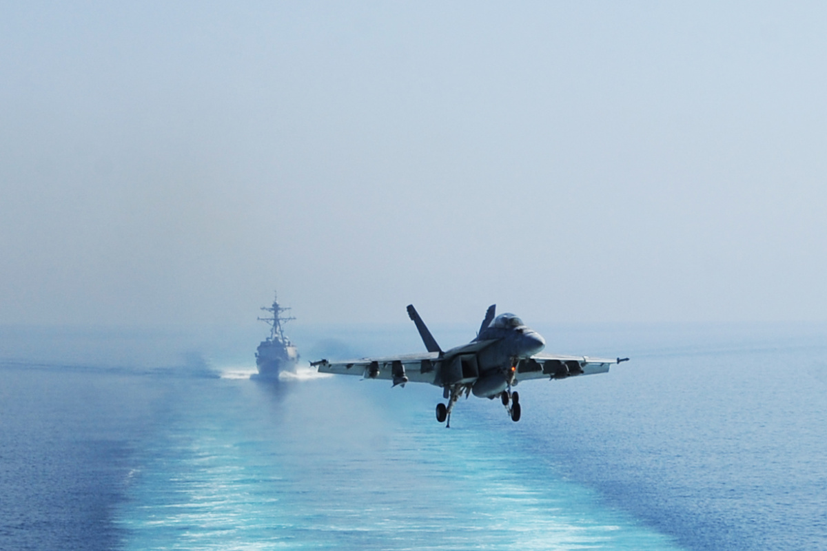 A U.S. Navy F/A-18F Super Hornet aircraft assigned to Strike Fighter Squadron (VFA) 213 prepares to land on the flight deck of the aircraft carrier USS George H.W. Bush (CVN 77), not shown, in the Persian Gulf Oct. 3, 2014, as the ship supports operations in Iraq and Syria. President Barack Obama authorized humanitarian aid deliveries to Iraq as well as targeted airstrikes to protect U.S. personnel from extremists known as the Islamic State in Iraq and the Levant. U.S. Central Command directed the operation