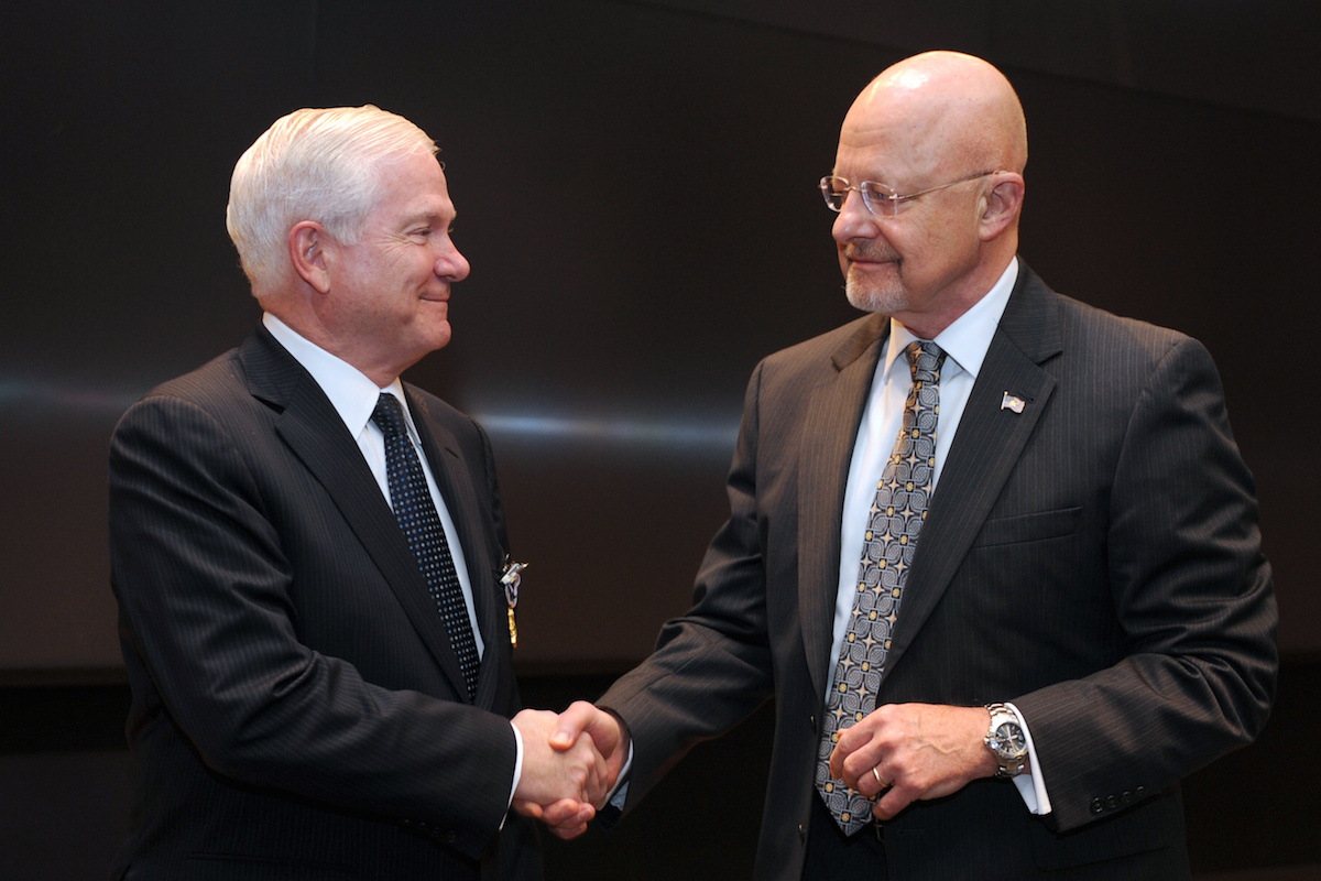 Defense Secretary Robert M. Gates shakes hands with Director of National Intelligence James R. Clapper. DVIDSHUB/Public domain
