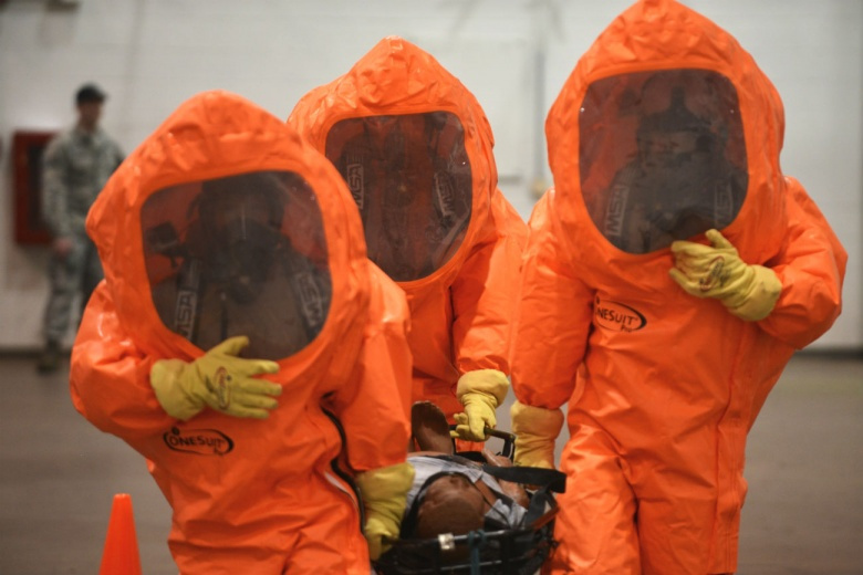 """Image: """"Emergency Managers from more than twenty Air National Guard units kicked off the first day of Global Dragon on March 9, 2015. Through the first set of scenarios, airman trained in Level A Hazardous Material suits, using their equipment to test for chemical, biological, radiological and nuclear (CBRN) contamination. The training emphasized coordination within small teams, with each airman working to support their wingman to accomplish the mission. Exercise Global Dragon is a two-week long course taki"""