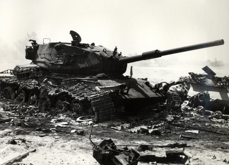 A knocked-out Israeli M60 tank amongst the debris of other armor during the Yom Kippur War. Wikimedia Commons/Public domain