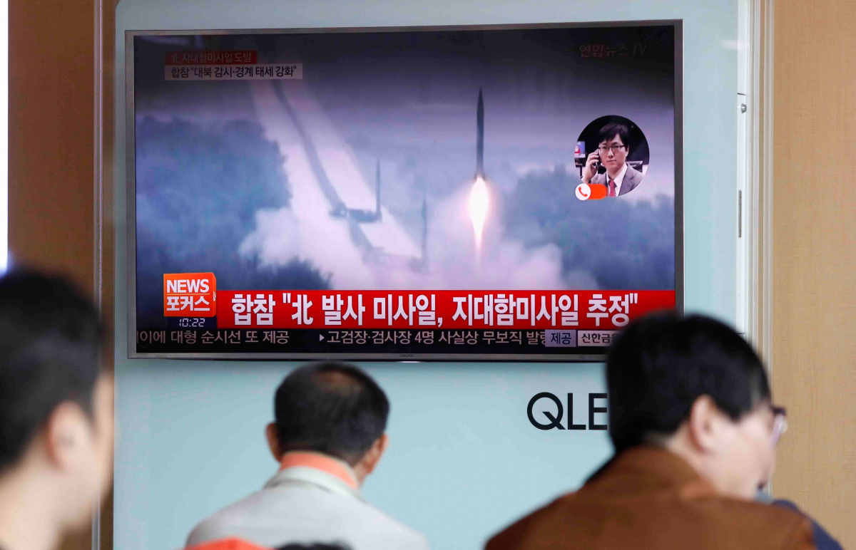 People watch a TV broadcast of a news report on North Korea firing what appeared to be several land-to-ship missiles off its east coast, at a railway station in Seoul, South Korea, June 8, 2017. REUTERS/Kim Hong-Ji