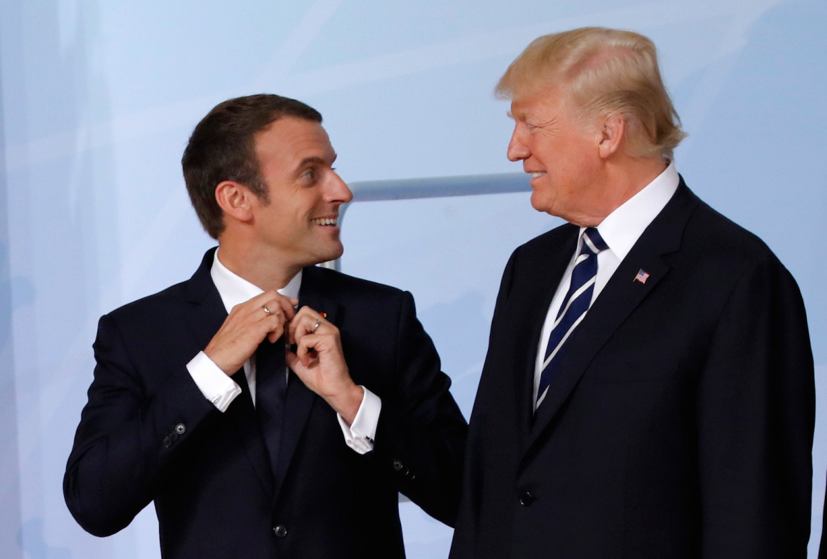 U.S. President Donald Trump looks at French President Emmanuel Macron before a family photo at the G20 summit in Hamburg, Germany July 7, 2017. REUTERS/Carlos Barria