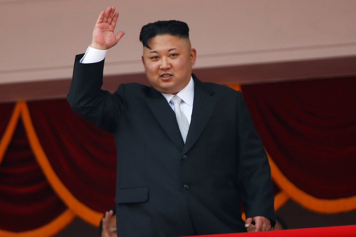 North Korean leader Kim Jong Un waves to people attending a military parade marking the 105th birth anniversary of country's founding father, Kim Il Sung