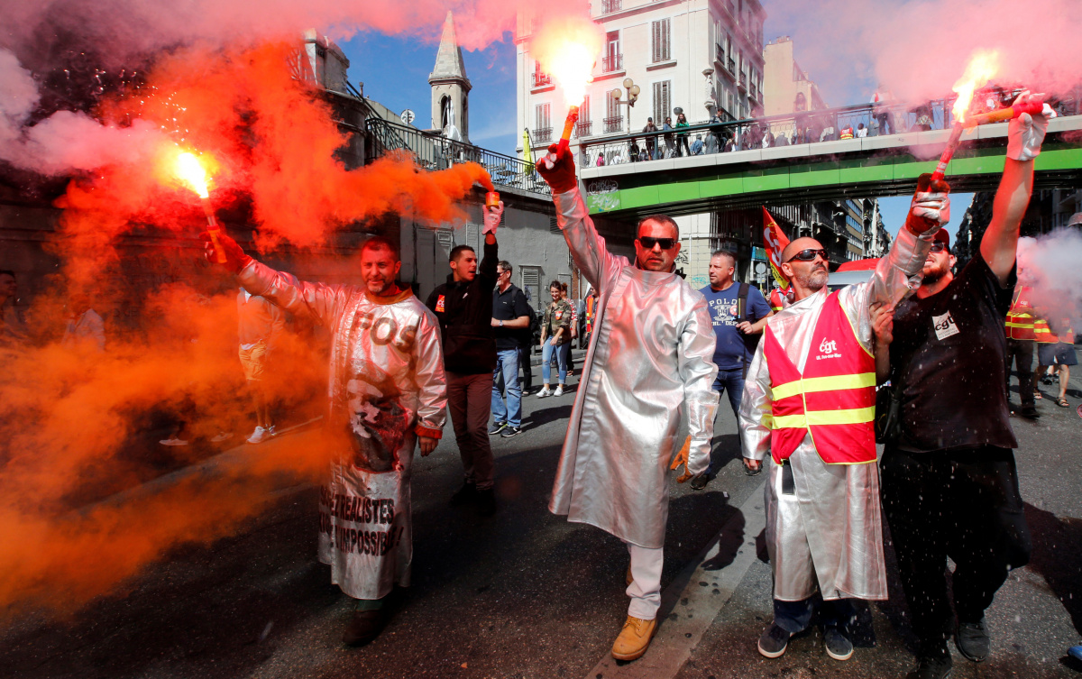 ArcelorMittal steel workers dressed in protective work suits attend a national strike and protest against the government's labour reforms in Marseille