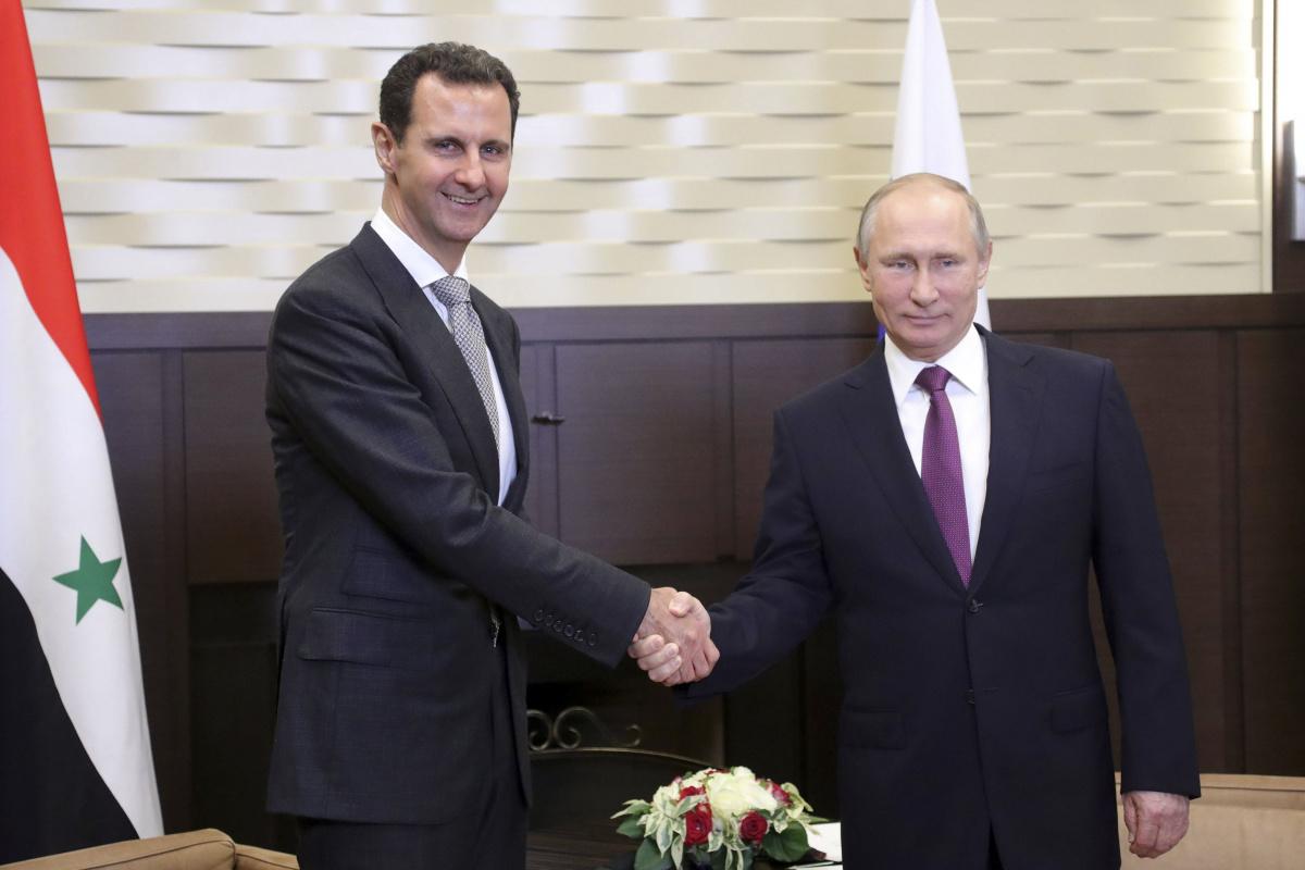 Vladimir Putin shakes hands with Bashar al-Assad during a meeting in the Black Sea resort of Sochi, November 20, 2017. Sputnik/Mikhail Klimentyev/Kremlin via Reuters