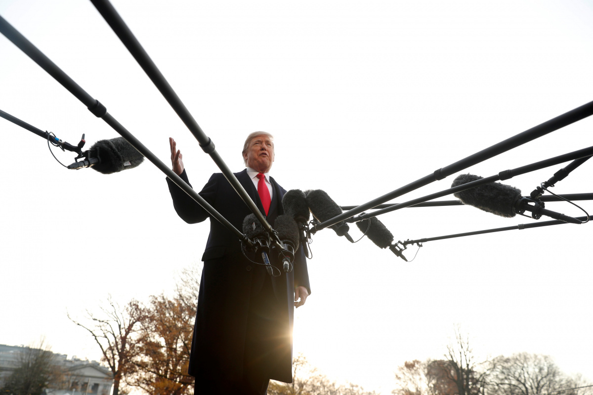 U.S. President Donald Trump speaks to reporters as he departs for travel to Utah from the White House in Washington, U.S. December 4, 2017. REUTERS/Jonathan Ernst