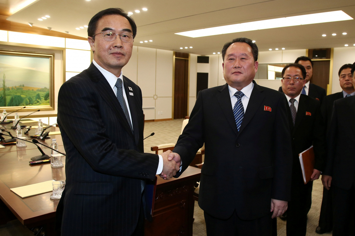 Ri Son Gwon shakes hands with South Korean counterpart Cho Myoung-gyon after their meeting at the truce village of Panmunjom, January 9, 2018. Reuters/Korea Pool