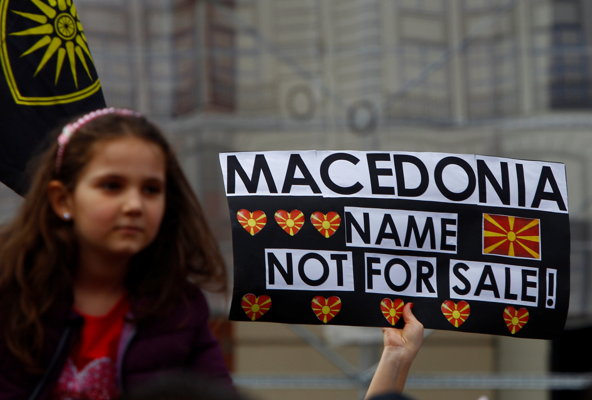 """A woman holds banner reading """"Macedonia name not for sale"""" during a protest organized by the """"We are Macedonia"""" movement as they rally against the name change demanded by Greece, in Skopje, Macedonia March 4,2018. REUTERS/Ognen Teofilovski"""