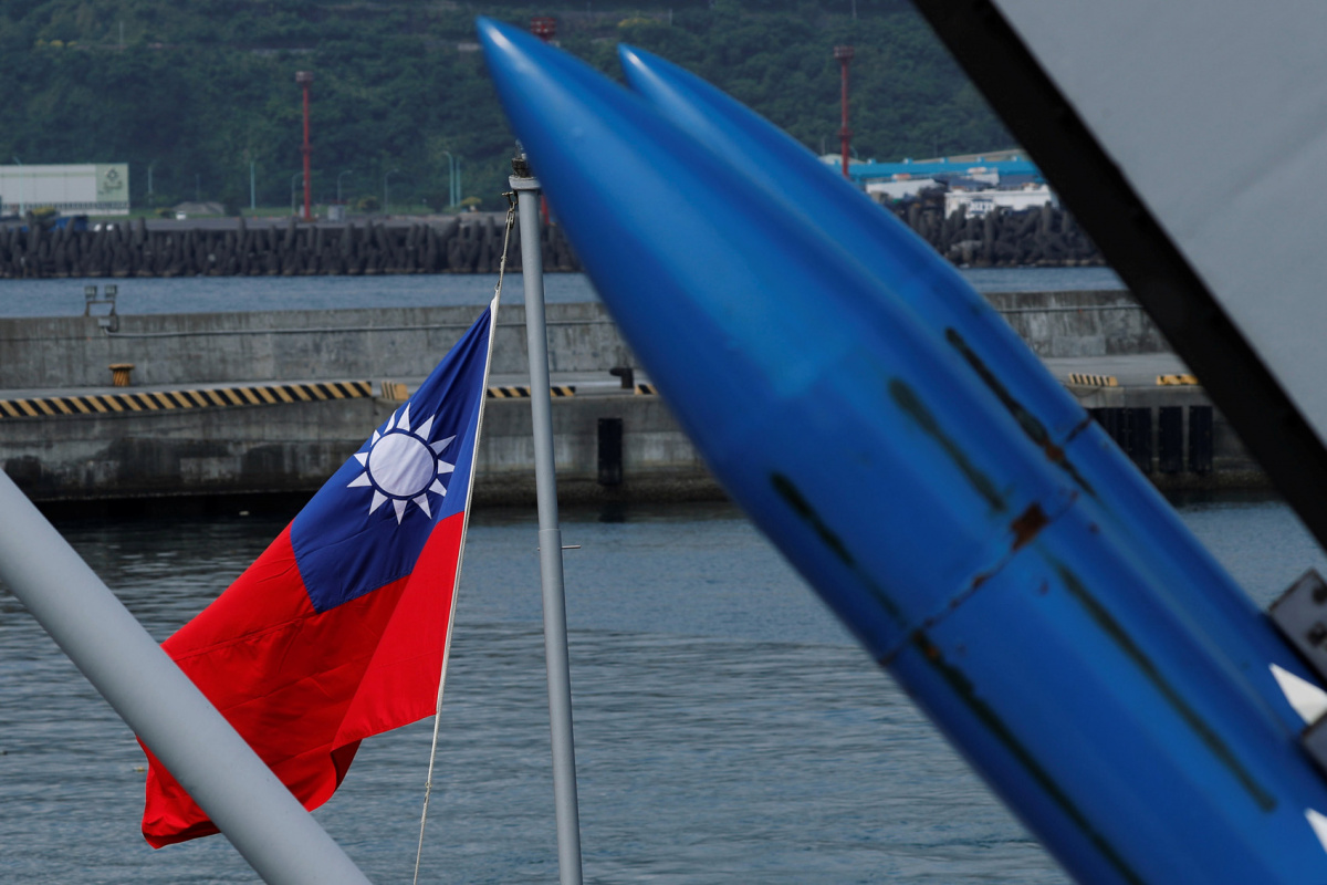 A Taiwanese flag is seen behind standard Type II missiles on Kee Lung (DDG-1801) destroyer during a drill near Yilan naval base, Taiwan April 13, 2018. REUTERS/Tyrone Siu