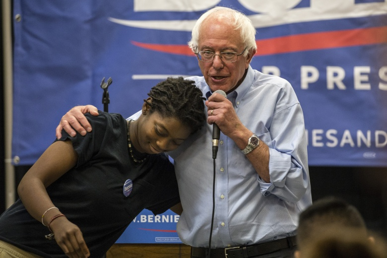 Image: Bernie Sanders hugs a supporter at a campaign event. Flickr.