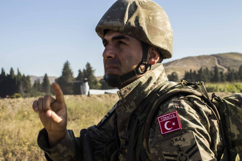 """Image: """"151027-M-ED118-004 DOGANBEY, Turkey (Oct. 27, 2015) A Turkish Marine gives hand signals during an amphibious assault as part of exercise Egemen 2015 in Doganbey, Turkey,, Oct. 27. Egemen is a Turkish-led and hosted amphibious exercise designed to increase tactical proficiencies and interoperability among participants. The 26th Marine Expeditionary Unit is deployed to the 6th fleet area of responsibility in support of U.S. national security interests in Europe. (U.S. Marine Corps photo by Cpl. Jalen"""