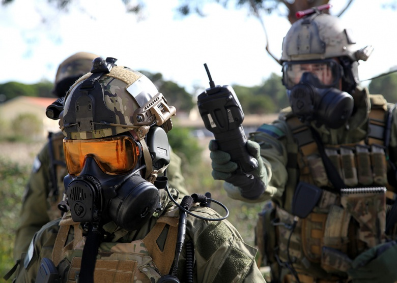 Soldiers in the Polish Multi-role exploitation Reconnaissance Team (MRT) conduct a security check on each other for radiation during CBRN training in Lisbon, Portugal on October 29, 2015 during NATO exercise Trident Juncture 15.