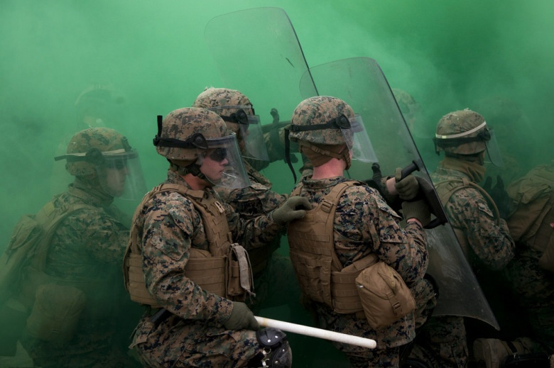 "Image: ""Marines with Battalion Landing Team, 1st Battalion, 6th Marine Regiment, 22nd Marine Expeditionary Unit performed many tactics to maintain control of a simulated riot during a non-lethal weapons course at Camp Lejeune, N.C., Jan. 22, 2016. The Marines participated in the course to ensure mission readiness and to improve their ability to maintain control during a riot. (U.S. Marine Corps photo by Cpl. Chris Garcia/Released)"""