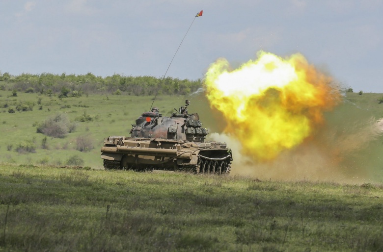 """Image: """"A Romanian T-55 Tank sends a blast downrange as it takes part in a live-fire exercise during Platinum Lynx 16-4 aboard Babadag Training Area, Romania, April 21, 2016. The purpose behind Platinum Lynx is to improve readiness and increase Marines' ability to work seamlessly with other NATO and partner nations around the world. (U.S. Marine Corps photo by Cpl. Immanuel M. Johnson/Released)."""""""