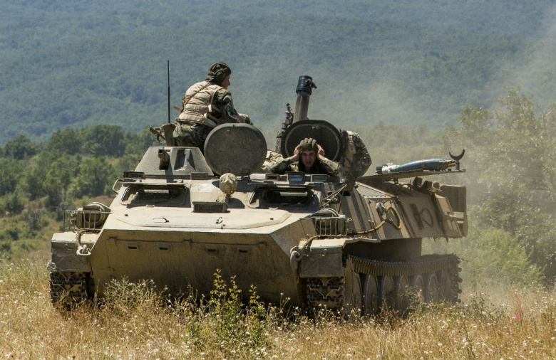 """Image: """"Bulgarian forces fire from a mobile mortar platform in a BMP-23 infantry fighting vehicle during Exercise Platinum Lion 16-4 aboard Novo Selo Training Area, Bulgaria, July 13, 2016. This multi-national exercise brings together eight NATO and partner nations for a live-fire exercise aimed to strengthen regional defense in Eastern Europe. (U.S. Marine Corps photo by Cpl. Kelly L. Street, 2D MARDIV COMCAM/Released)"""""""