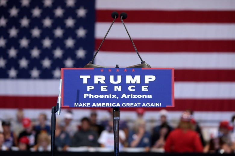 """Image: """"Podium at a campaign rally with Governor Mike Pence at the Phoenix Convention Center in Phoenix, Arizona."""" Photo by Gage Skidmore, CC BY-SA 2.0."""