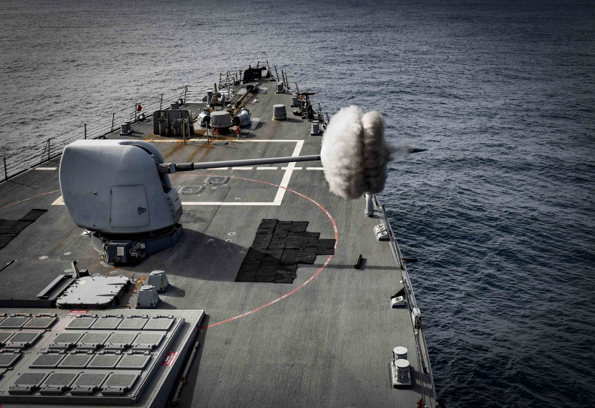 USS Oscar Austin fires its Mark 45 5-inch gun during a live-fire exercise.