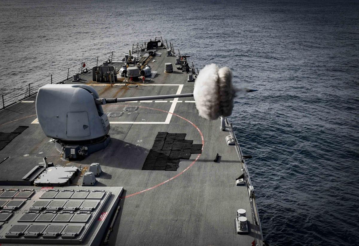 USS Oscar Austin fires its Mark 45 5-inch gun during a live-fire exercise.